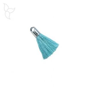 Pompon en tissu bleu turquoise avec embout argenté et anneau