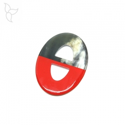 Oval buffalo horn pendant with red lacquered part.