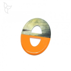 Oval buffalo horn pendant with orange lacquered part.