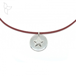 Silver plated pendant with star in relief.