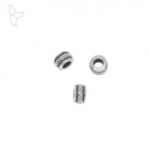Petite perle rondelle argentée trou 4.15 mm