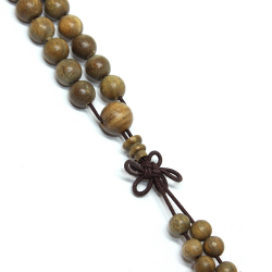 Mala necklace made of 108 clear aloe wood pearls.
