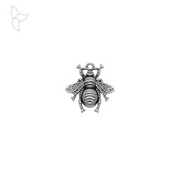 Silver-plated serrated bee pendant.