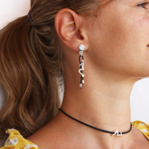 Silver color dancer pendant or connector.