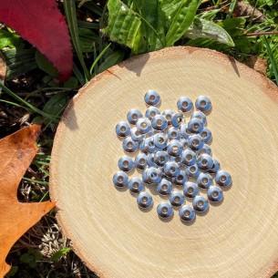 Perles en forme de lentilles