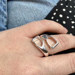 Silver plated ring formed of 2 horsebits that cross each other.
