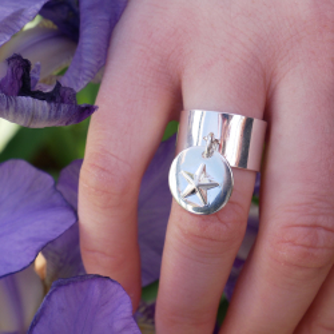 Medaglia placcata argento 10 micron 16 mm stella in rilievo per 10 pezzi