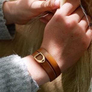 Stirrup slider for leather 10mm gold color.