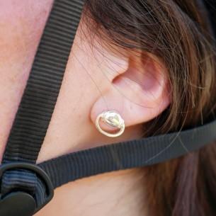 Silver plated horsebit head earring.