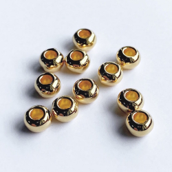 Round gold beads 7 x 5.2 mm hole 3 mm
