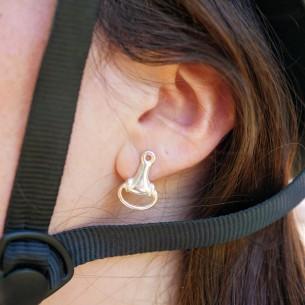 Silver plated horsebit earring.